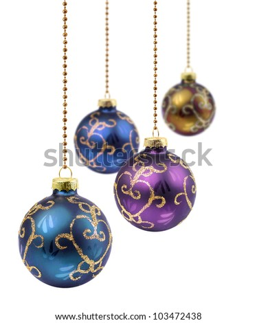 Four retro color Christmas balls hanging on white background isolated
