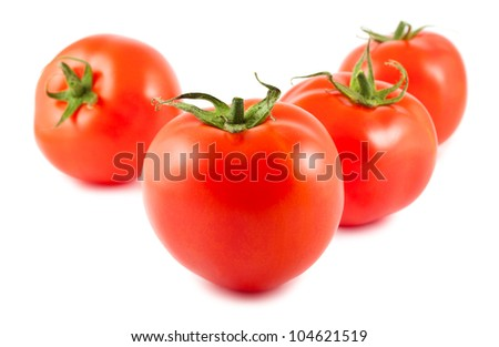 Four ripe tomatoes isolated on white background
