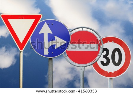Four road sign on a sky background