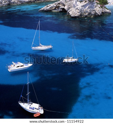 Four sail boats in the waters of Paleokastritsa, Corfu, Greece