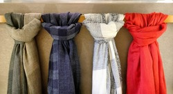 Four scarves tied on the hanging bar