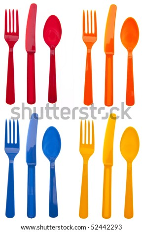 Four Sets of Vibrant Plastic Forks, Knives and Spoons in Red, Orange, Yellow and Blue.  Isolated on White with a Clipping Path.