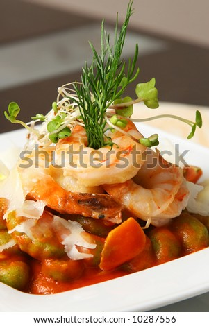 four shrimps with caper and artichoke on the table