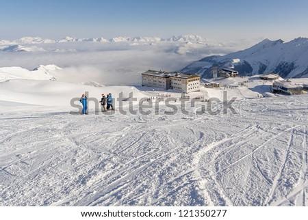 four skier on the background of ski chool - Kaprun, Austria