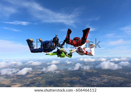 four skydivers in the sky. side ...
