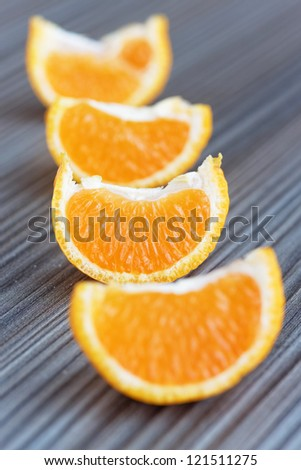four slice of orange on a wooden table, selective focus