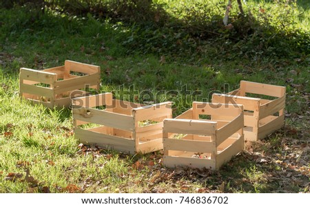 four small wooden crates for fruits and vegetables #746836702