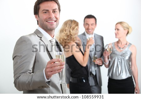 Four smartly dressed people - stock photo