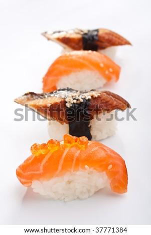 four smoked eel sushi and salmon sushi - stock photo