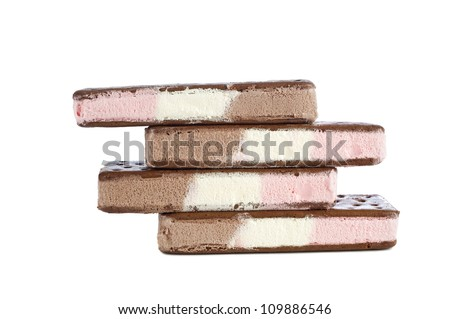 Four stacked neapolitan ice cream sandwiches with vanilla, chocolate and strawberry flavors