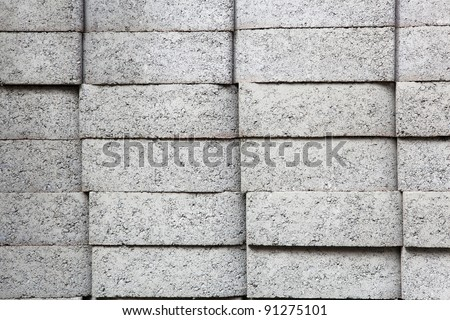 Four stacks of Gray rectangular pavers at a hardware store