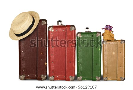 Four Suitcases with Summer Hat and Cuddly Bunny