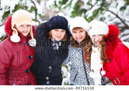 Four teen friends in a winter park