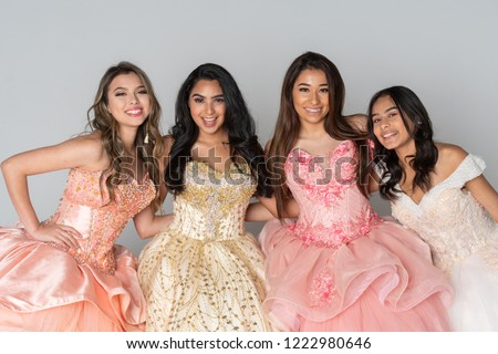 Four teenage girls at their quinceanera party