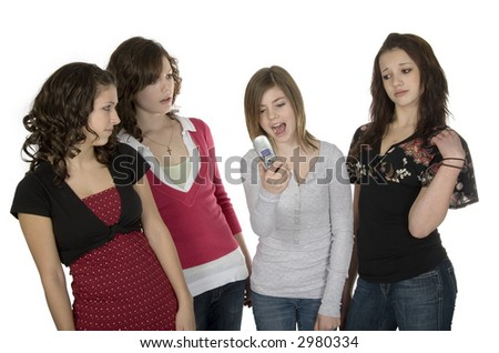 Four teenage girls standing with cellphone