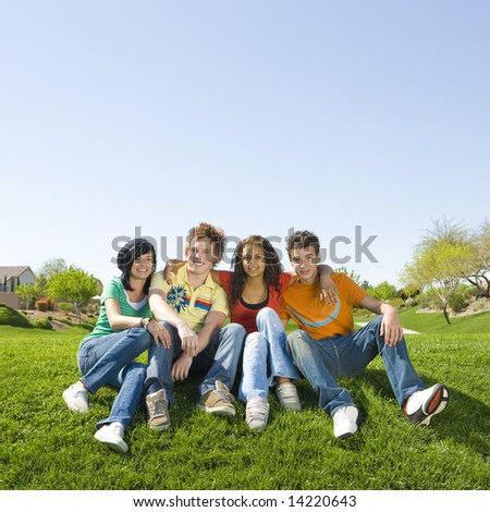 Four teens hang out in a park