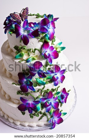 Four tier wedding cake with purple flowers