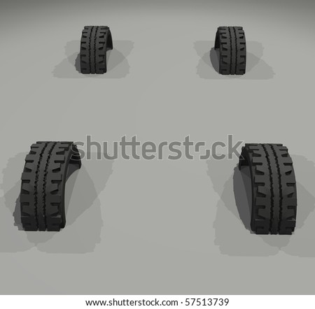 Four tires buried in the ground.