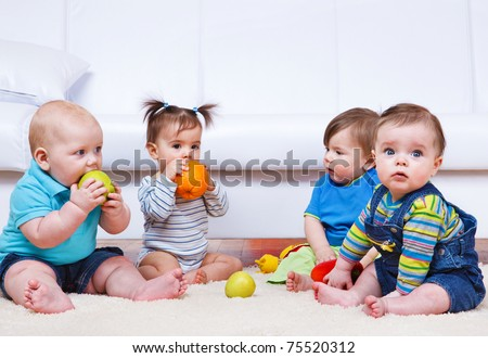 Four toddlers sitting in a lounge
