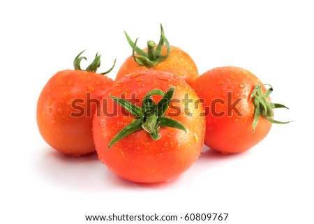 Four tomatoes with water drops, with branches isolated on a white background with a shadow