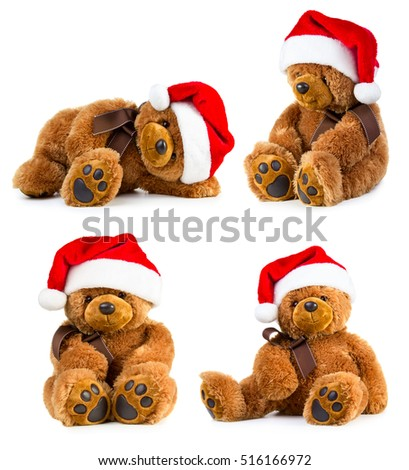 Stock Photo Four toy teddy bear wearing a santa hat isolated on white background