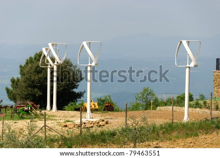 four vertical wind turbines in Tuscany