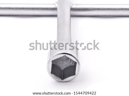 four way wrench,cross wrench or lug wrench closeup detail #1544709422
