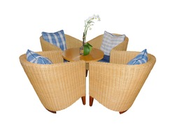 Four wicker chairs surrounding a small round table, Isolated on white.