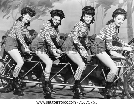 Four women on a bicycle