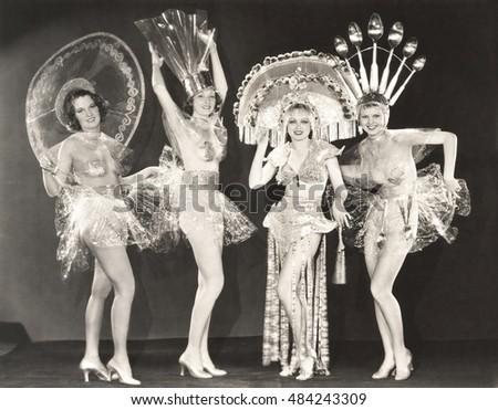 four women wearing funny hats...