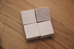 Four wooden cubes blocks with empty copy space for message word.News symbol background.