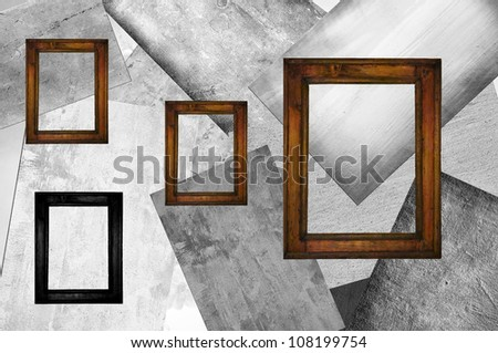 Four wooden frames, three brown and on black, on a background of different squares in gray.