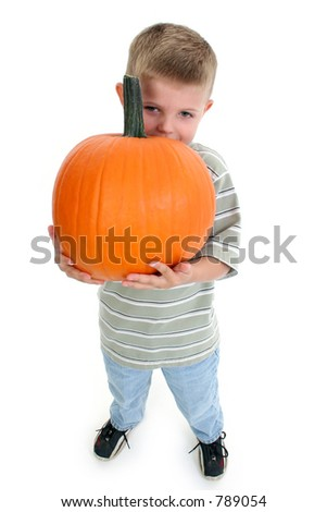Four year old boy holding pumpkin.
