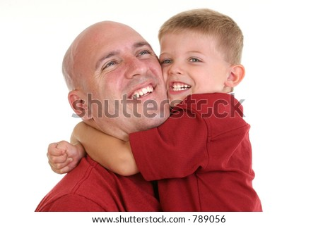Four year old boy hugging his dad around the neck. - stock photo