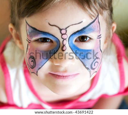 four years old girl with painted face