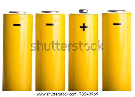 four yellow batteries with plus and minus standing