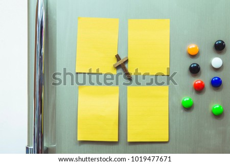 Magnetic, colourful letters on a fridge door Images and