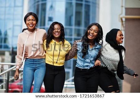 Four young college african american woman friends spend time together.