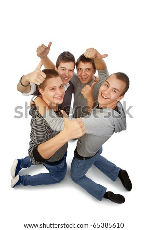 Four young friends knelt rejoicing for their success