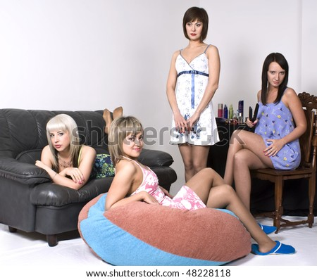 Four young girls gather at a party