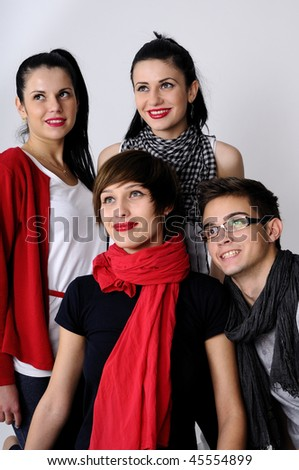 four young people smiling