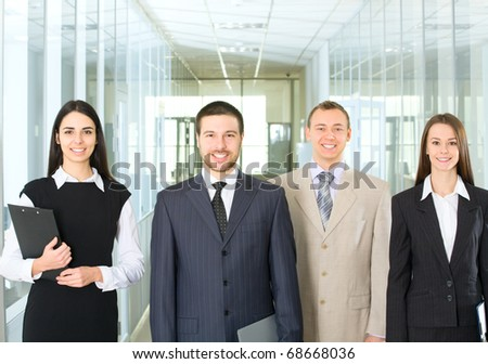 Four young professionals looking at camera