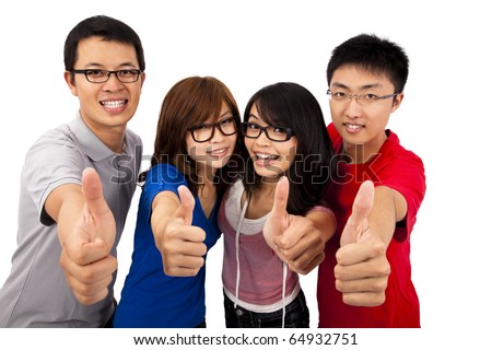 Four young student laughing and giving the thumbs-up