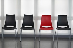 Fours chairs in line against wall