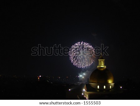 Fourth of July fireworks in Boston Massachusetts above the Charles River behind the State House