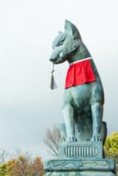 Fox statue at Fushimi Inari shrine in Kyoto, Japan on rainny day