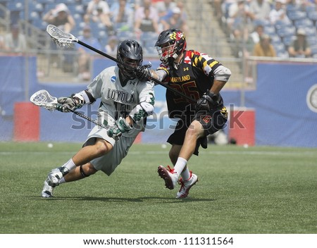 FOXBOROUGH - 28 MAY: Mike Scheeler (15), Loyola, drives to the net against Jesse Bernhardt (36), Maryland, College Park, at the NCAA Men's Division 1 Lacrosse Championship game, 28 May 2012 in Foxborough, Massachusetts
