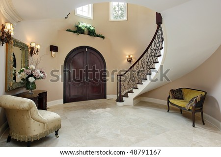 stock photo : Foyer in luxury home with curved staircase