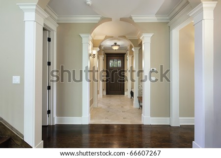 Foyer in new construction home with arched entry