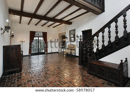Foyer in traditional home with wood beams